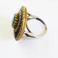 Кольцо с изумрудом и топазами