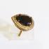 Кольцо с ониксом и топазами