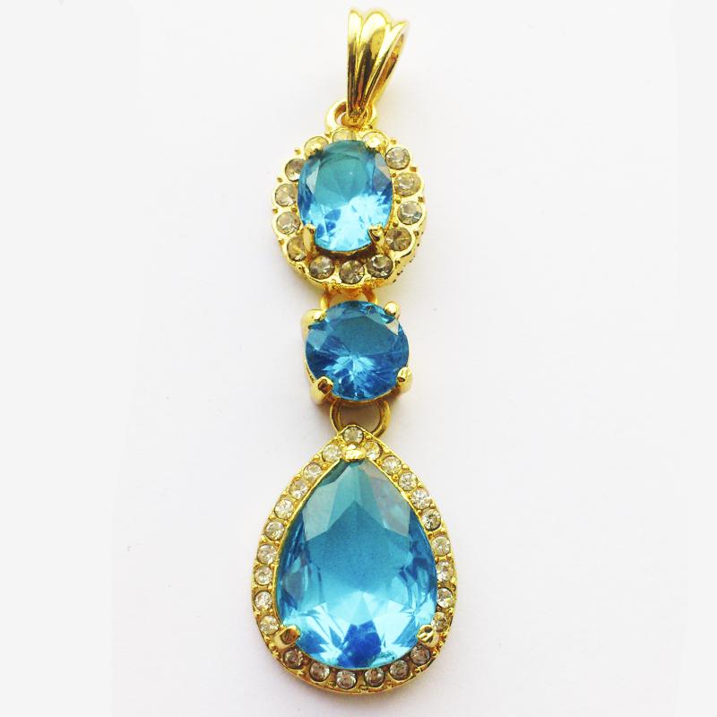 Крупный кулон с голубыми камнями