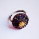 Кольцо с разноцветными камнями